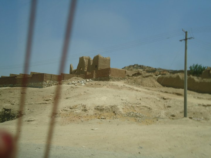 On the way to Arghandeh. At the time, a man was buried near this ruin. For an entire week after his burial, his body ended up dug up next to his grave. The town speculated that he must have been such a bad person, the ground was pushing him out of his grave every night.