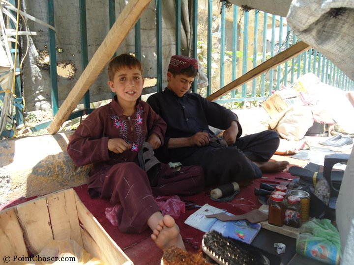 Brothers repairing shoes in the Golden City area of Kabul