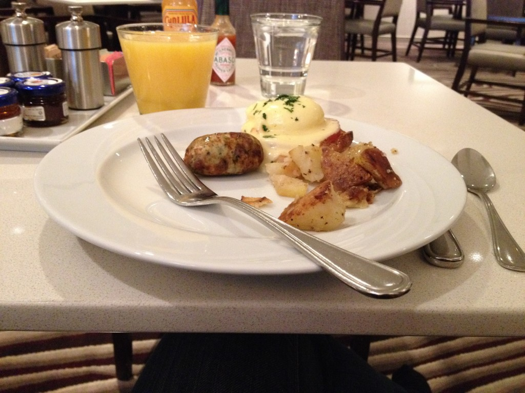 Breakfast at Vines Cafe: Eggs Benedict, Chicken Sausage, and Potatoes
