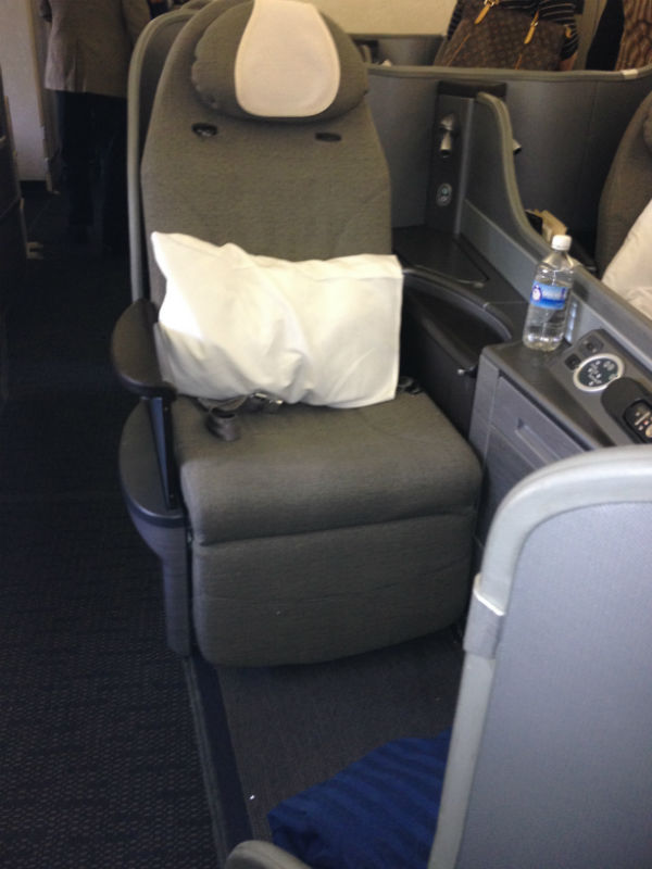 United Global First aisle seat - a bit less storage space than the window seats