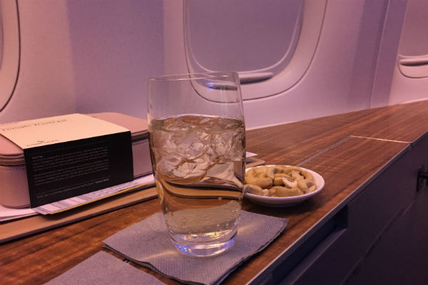 Cathay Pacific First Class peanuts served shortly after take-off