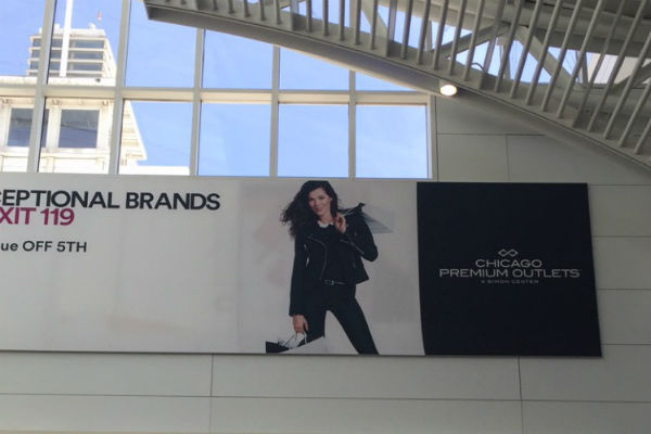 A Simon Mall ad greeting me at immigration - a reminder to get back in the game