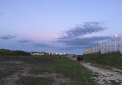 The Calais Jungle refugee camp at sunset