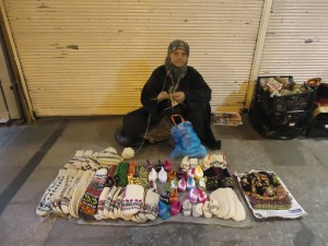 One of the many ladies knitting on the sidewalk of Old Town Istanbul