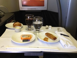 United Airlines Global First Class 747 HNL - NRT Meal Sushi and Spring Roll