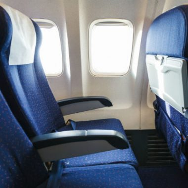 Economy class seat on airplane