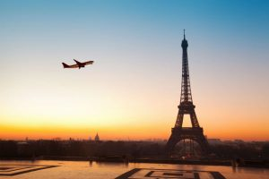 Airplane Flying Over Eiffel Tower Paris